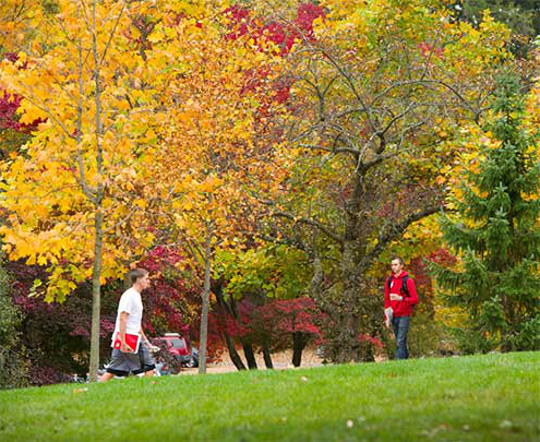 two students walking through florham campus